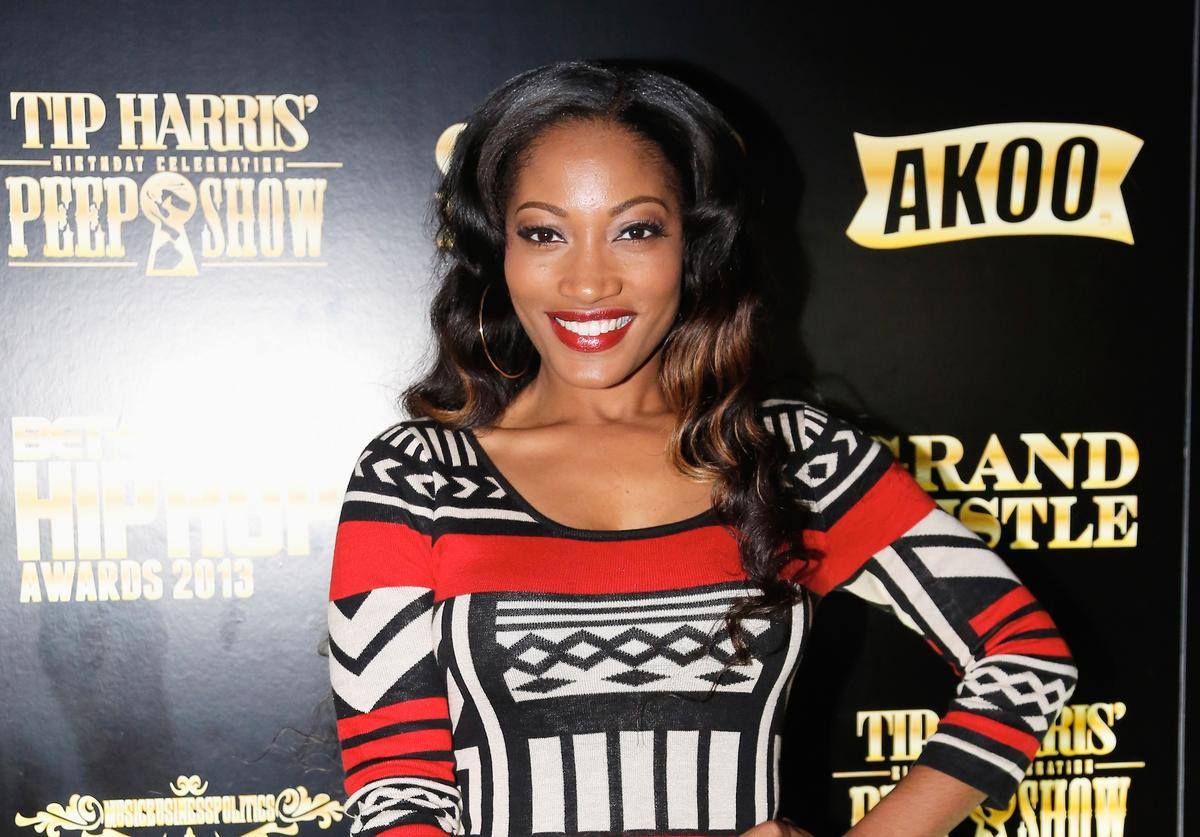 Love and Hip Hop TV Star Erica Dixon pose on the red carpet as GREY GOOSE
