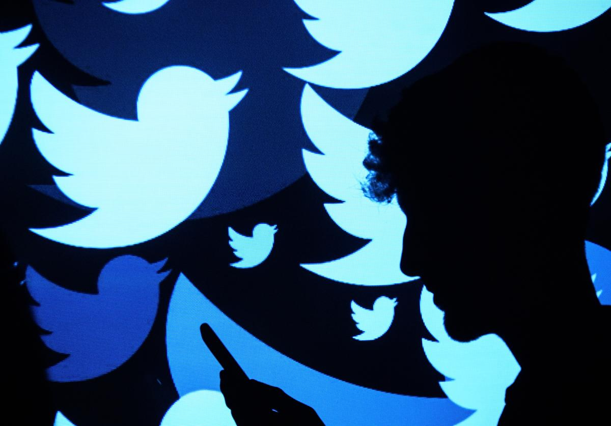 In this photo illustration, the logo for the Twitter social media network