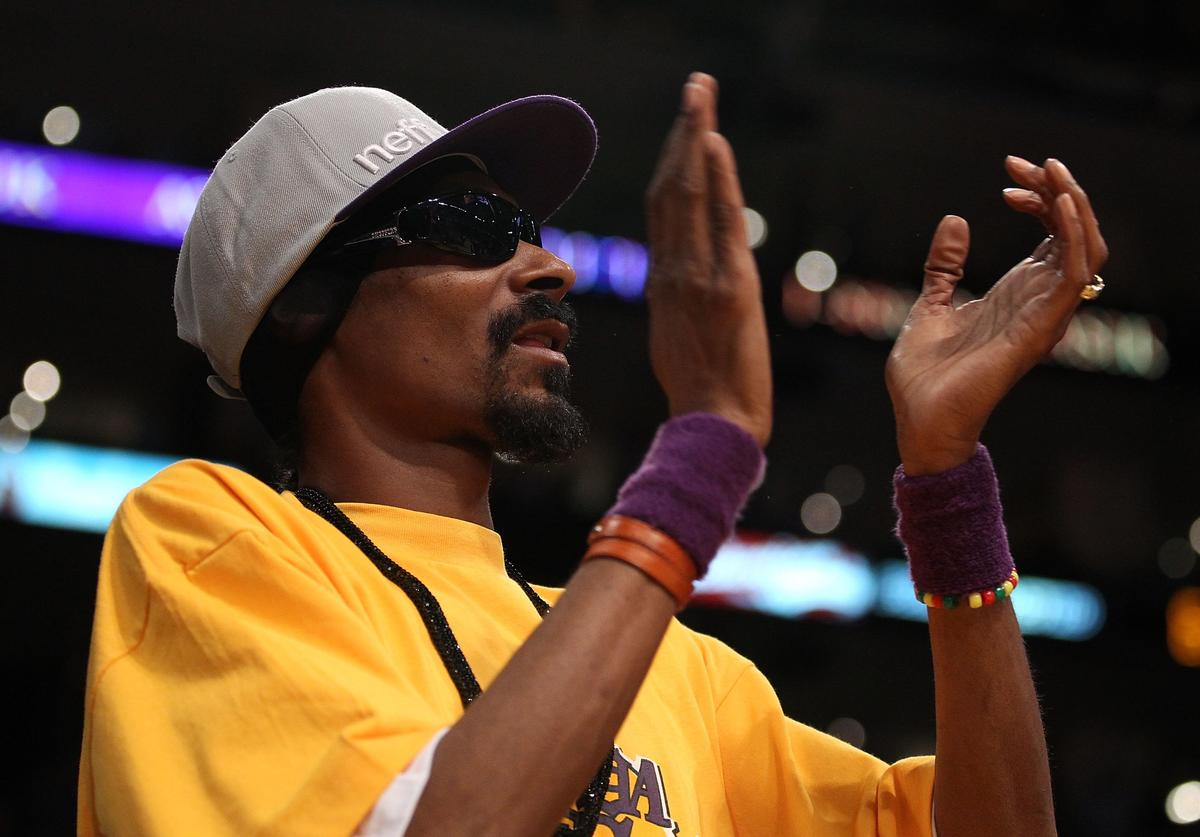 Snoop Dogg sits courtside in Game Six of the 2010 NBA Finals between the Boston Celtics and the Los Angeles Lakers at Staples Center on June 15, 2010 in Los Angeles, California