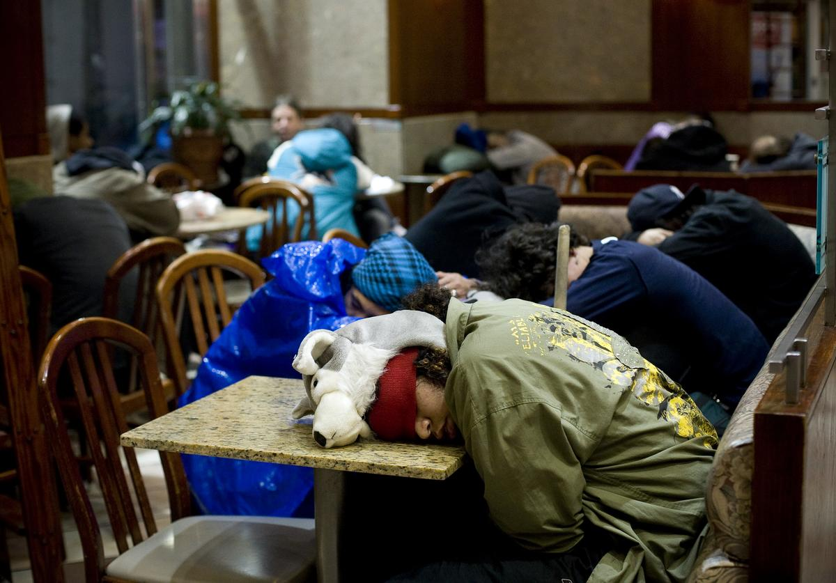 Occupy Wall Street protesters sleep in a McDonalds near Zuccotti Park on November 16, 2011 in New York City.