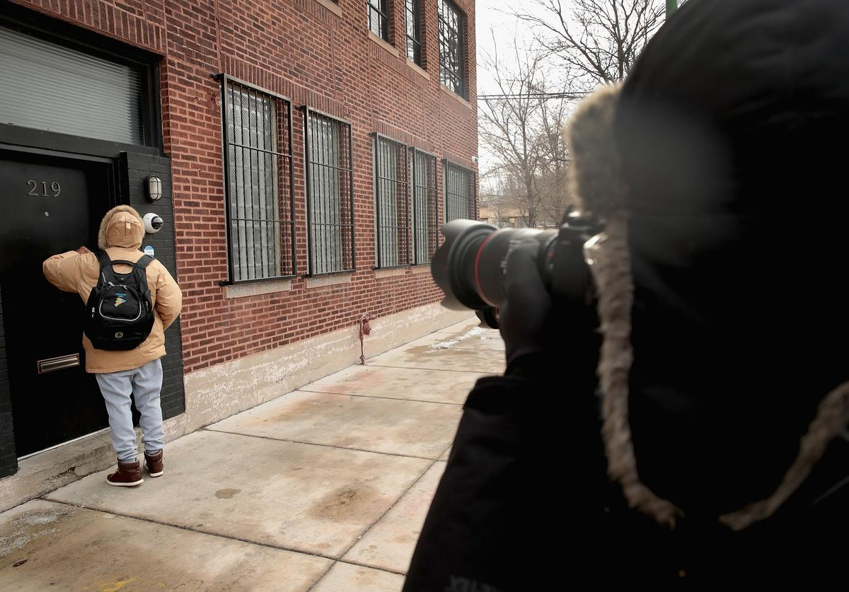 News crews document as a visitor arrives at the recording studio of R. Kelly in front of a planned visit by city inspectors on January 16, 2019 in Chicago, Illinois