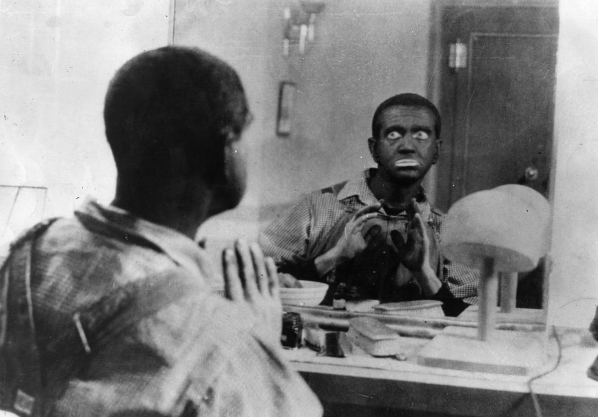 American film star Al Jolson (1886 - 1950) wearing his famous 'black-and-white minstrel' make-up.