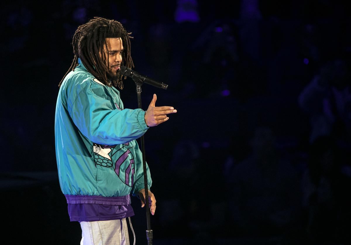 Rapper J. Cole performs during halftime of the 68th
