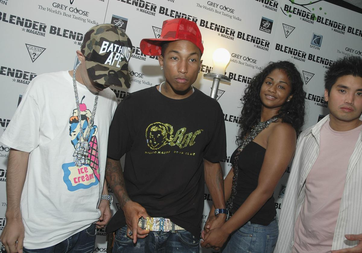 AUGUST 28: Pharrell Williams with his girlfriend, designer Nigo and Chad Hugo attends the Blender Magazine VMA Pre-Party on August 28, 2004 at The Shore Club, in Miami Beach, Florida.