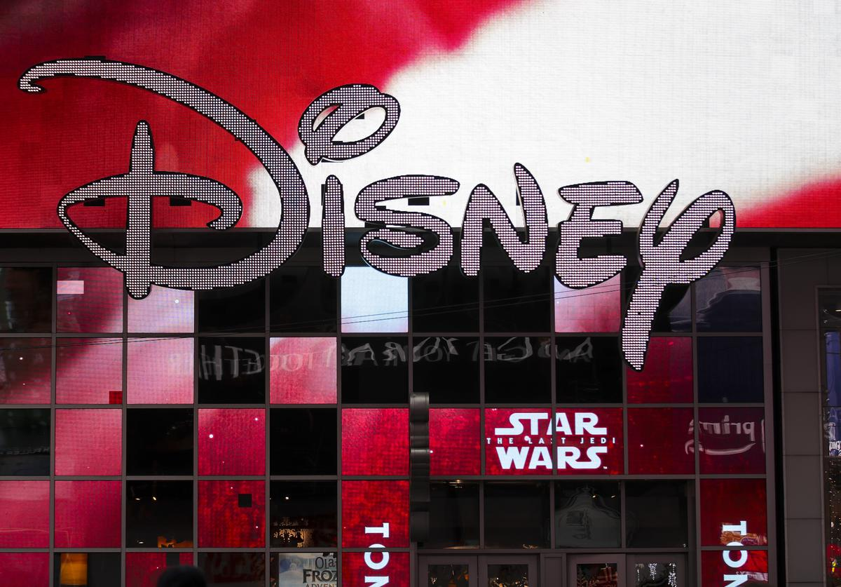 The Disney logo is displayed outside the Disney Store in Times Square, December 14, 2017