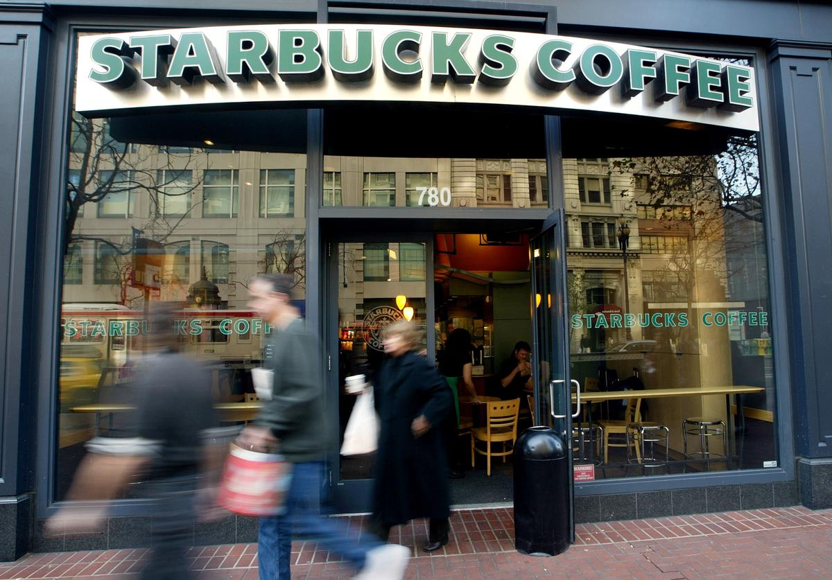 People walk out of a Starbucks coffee shop January 22, 2004 in San Francisco, California