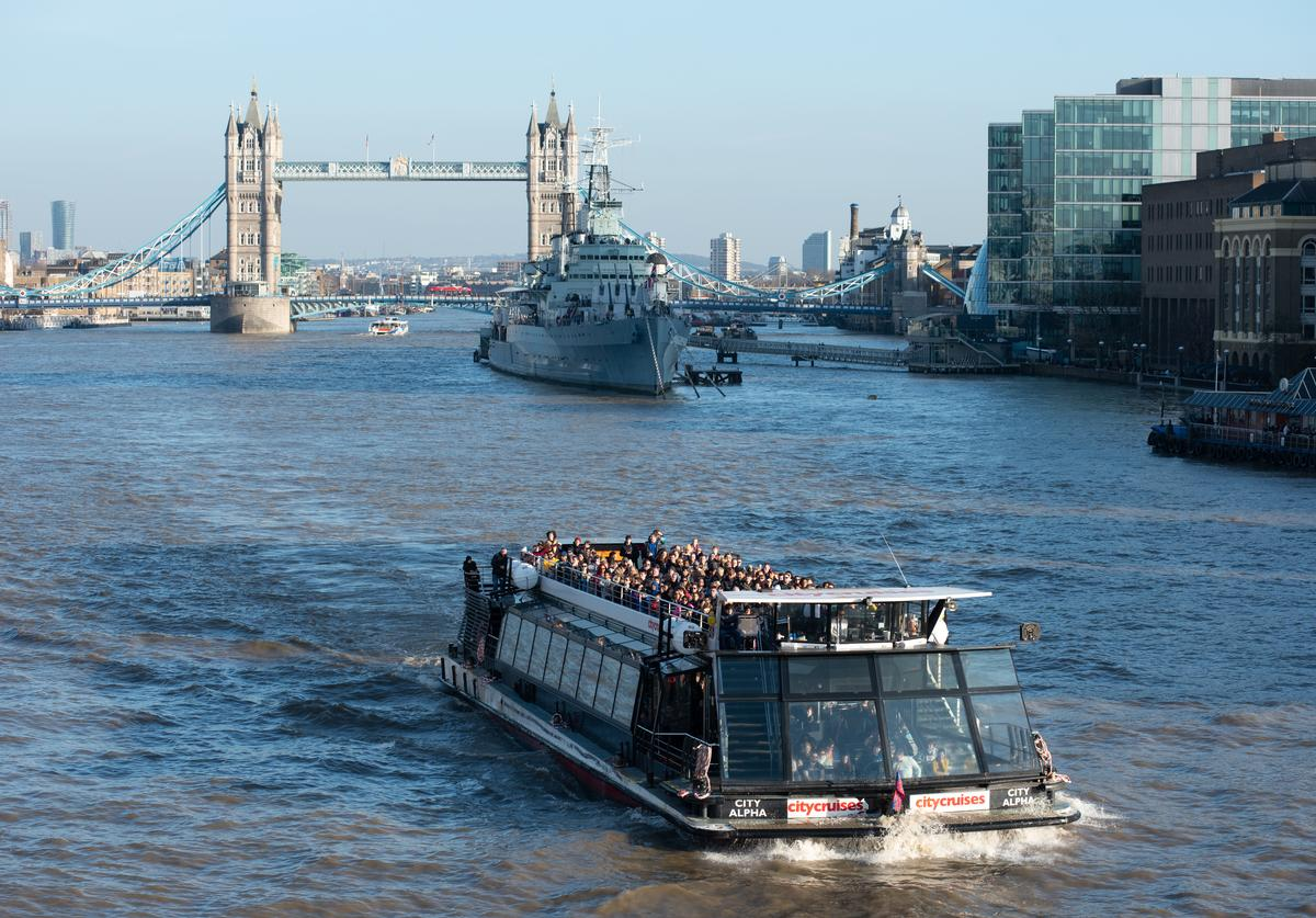 People enjoy a pleasure cruise boat trip in the sun on the River Thames on February 21, 2019 in London, England.