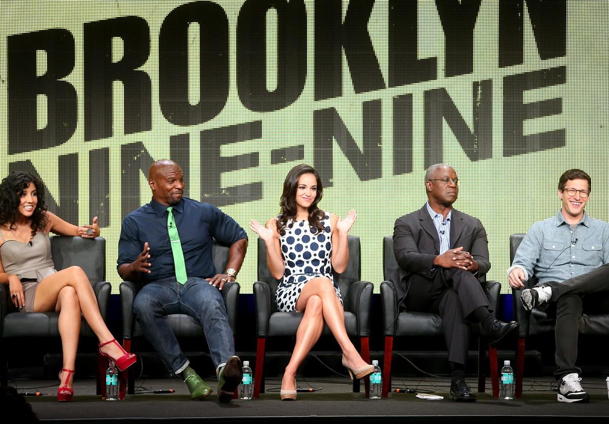 "Actors Stephanie Beatriz, Terry Crews, Melissa Fumero, Andre Braugher, and Andy Samberg speak onstage during the ""Brooklyn NINE-NINE"" panel discussion at the FOX portion of the 2013 Summer Television Critics Association tour - Day 9 at The Beverly Hilton Hotel on August 1, 2013 in Beverly Hills, California."