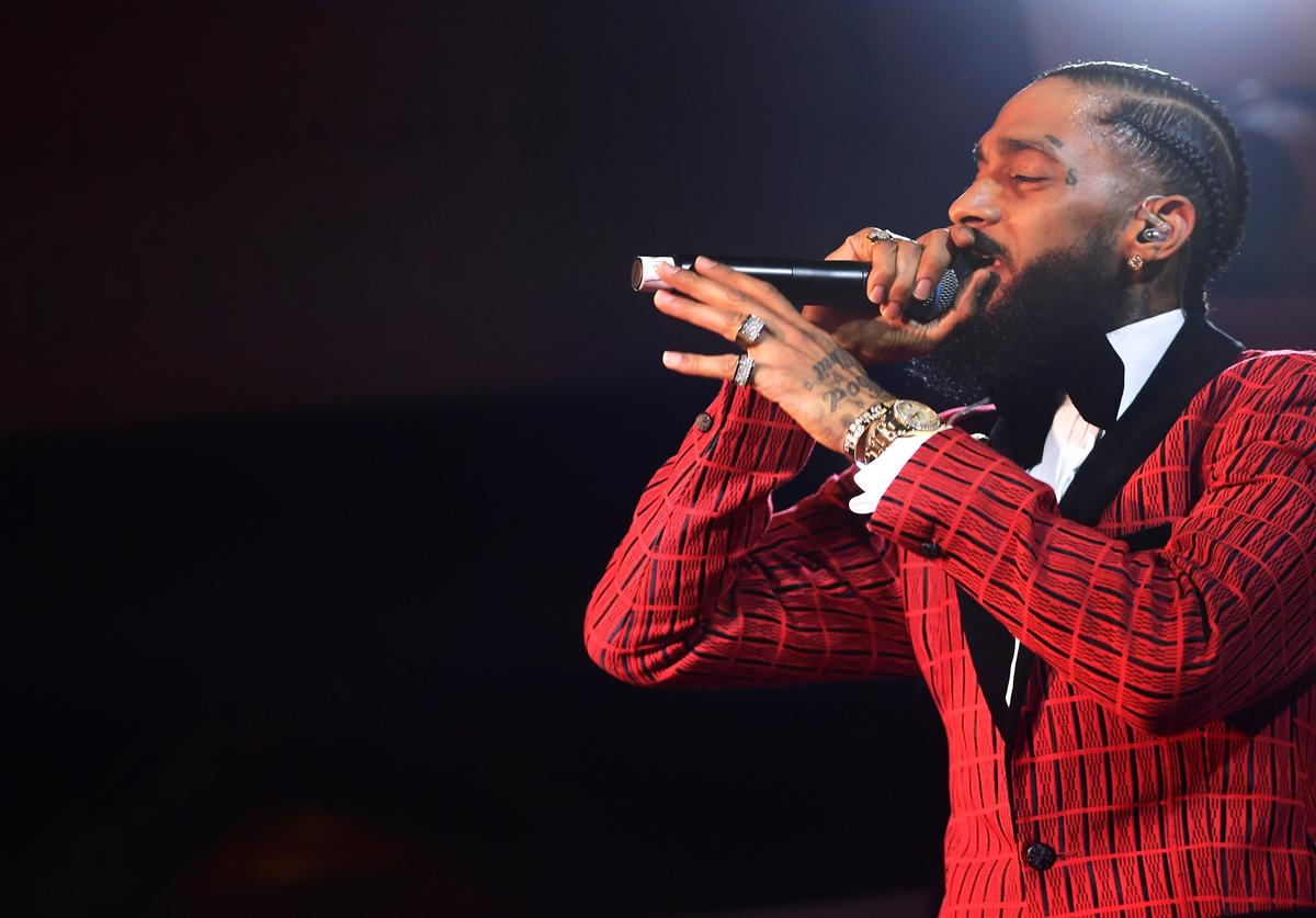 Nipsey Hussle performs onstage at the Warner Music Pre-Grammy Party at the NoMad Hotel
