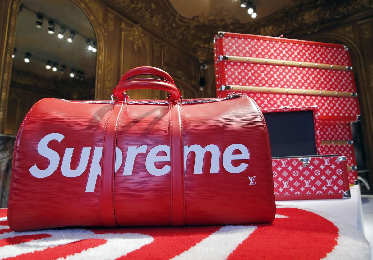 """A travel bag entitled """"Keepall"""" by Louis Vuitton x Supreme is displayed during the exhibition """"The Rise of Supreme / 30 years of American urban culture"""" at Artcurial auction house on May 14 2018 in Paris, France."""