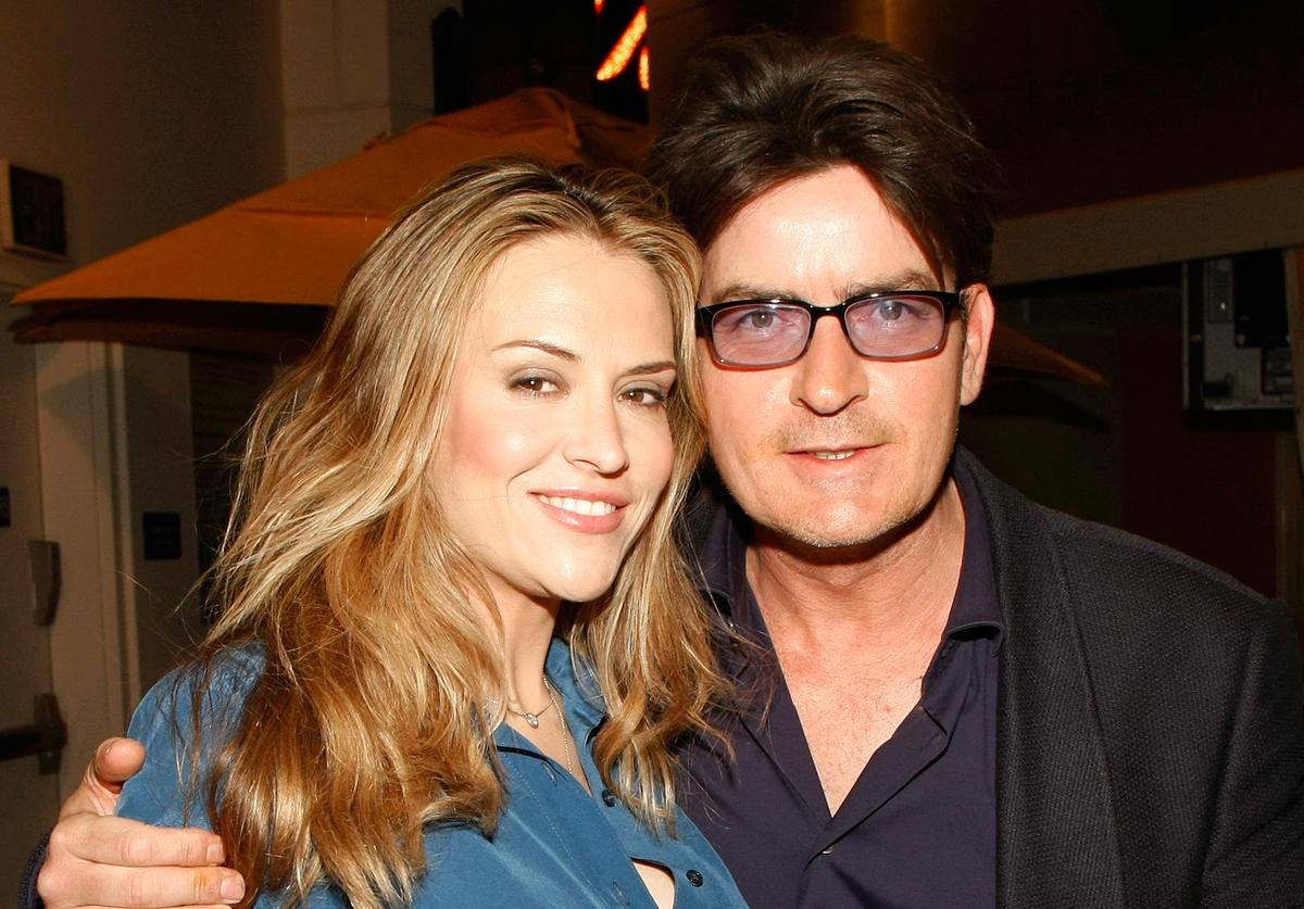 "Charlie Sheen (R) and his wife Brooke Sheen appear at the after party for the world premiere of the adult production ""PEEPSHOW"" at the Planet Hollywood Resort & Casino April 18, 2009 in Las Vegas, Nevada"