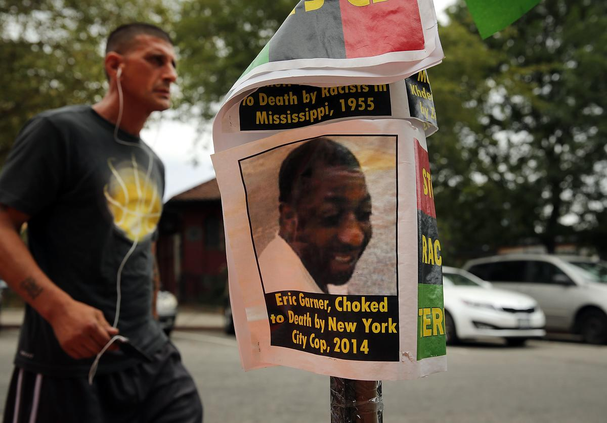 A flyer with a picture of Eric Garner is seen near where he was killed in an encounter with an NYPD officer in July on August 22, 2014 in the borough of Staten Island in New York City. Thousands of marchers are expected for the afternoon rally which will be attended by the family of Michael Brown and the Reverend Al Sharpton among others. Eric Garner, 43, died while he was being arrested for allegedly selling loose cigarettes in front of a bodega and was put into a chokehold during a confrontation with police. An investigation is pending and the police officer who allegedly used the illegal chokehold has been placed on modified duty.
