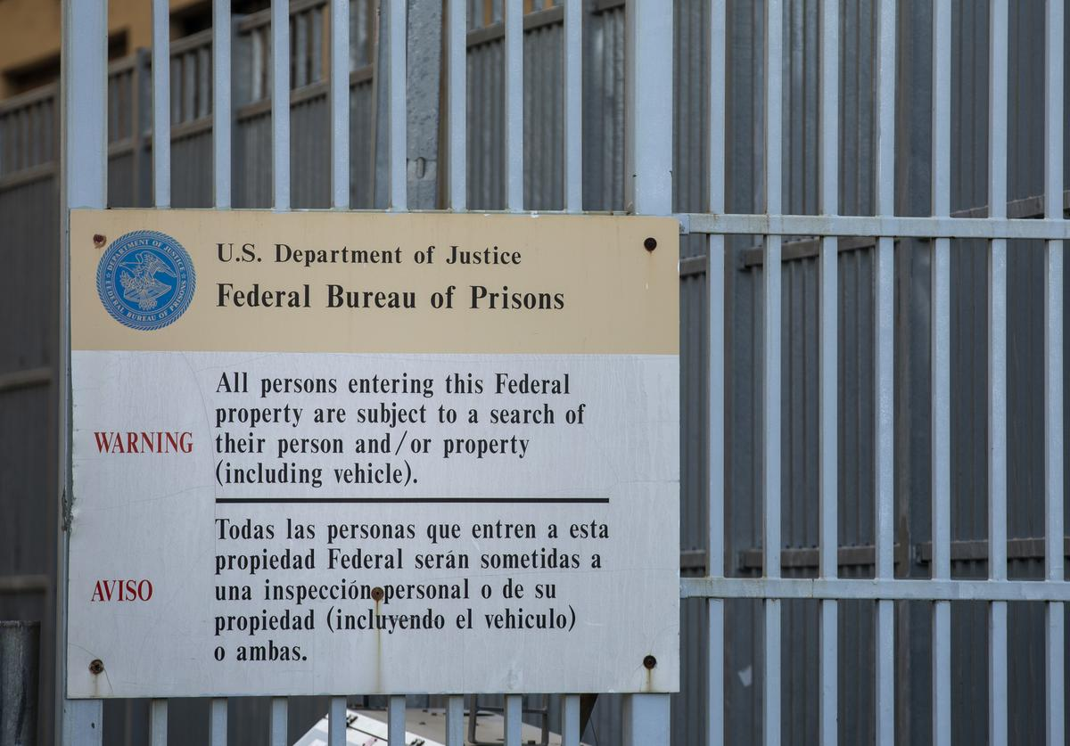 A sign is posted outside the Metropolitan Detention Center on February 4, 2019 in the Brooklyn borough of New York City. Power has been fully restored to the prison after inmates suffered the past week without heat and access to televisions, computers or telephones. On Monday morning, the facility received a bomb threat following a weekend of protests.