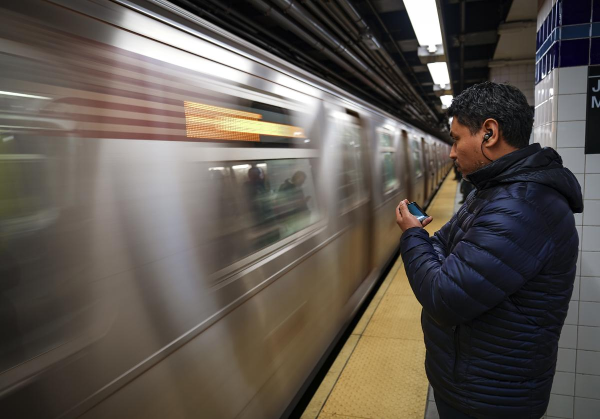 A rider waits for an arriving train at the Jay Street Metro Tech subway station, February 27, 2019 in New York City