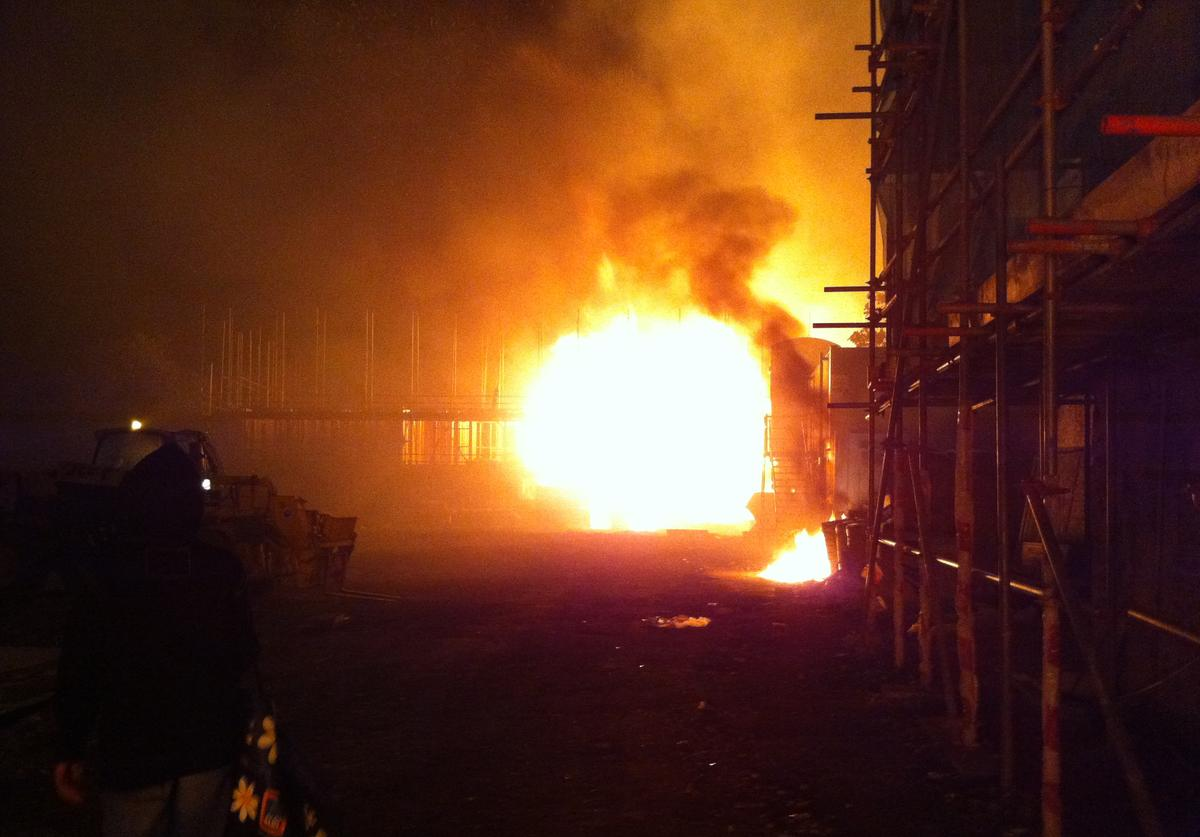 A fire burns at a construction site during a riot after youths protested against the killing of a man by armed police in an attempted arrest, August 6, 2011 in London, England.