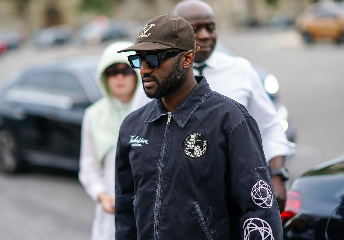 Virgil Abloh wears a brown Vuitton cap, a jacket with patches, outside Celine, during Paris Fashion Week - Menswear Spring/Summer 2020, on June 23, 2019 in Paris, France.
