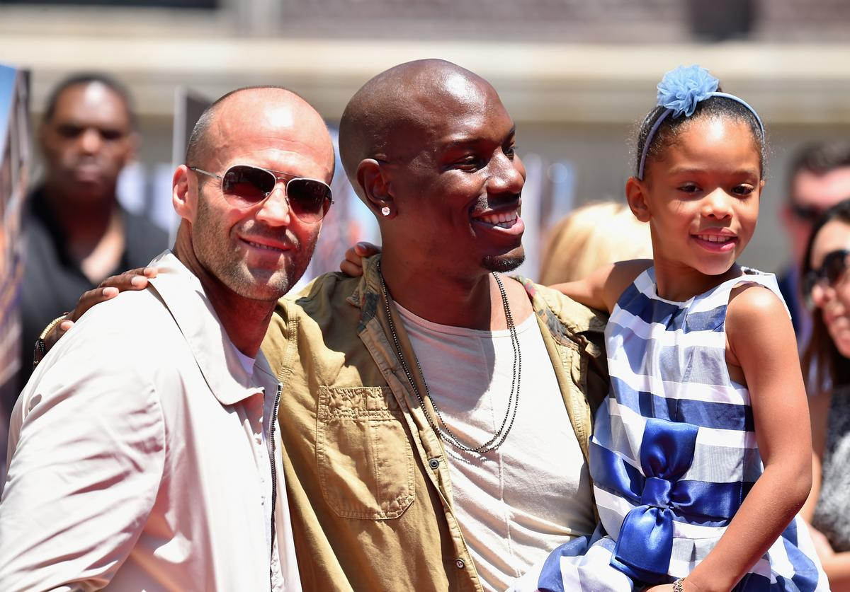 """Actors Jason Statham, Tyrese Gibson and daughter Shayla Gibson attend the premiere press event for the new Universal Studios Hollywood Ride """"Fast & Furious-Supercharged"""" at Universal Studios Hollywood on June 23, 2015 in Universal City, California."""