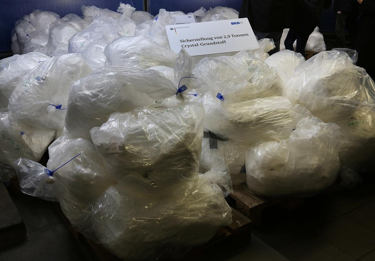 Members of the Bundeskriminalamt German law enforcement agency (BKA), the Federal Criminal Office, display portions of 2.9 tonnes of recently-confiscated chlorephedrin, one of the main ingredients used to manufacture methamphetamine, also called crystal meth, at a press conference on November 13, 2014 in Wiesbaden, Germany. Police from Saxony, Thuringia and the Czech Republic broke a crystal meth manufacturing ring earlier this month and confiscated the haul, which is enough to produce 2.3 tonnes of crystal meth, and also made at least 16 arrests, including the ring leader, a 32-year-old pharmaceuticals retailer from Leipzig. Crystal meth has evolved into a major scourge in the Czech-German border region and is becoming a popular drug in cities deeper inside Germany.