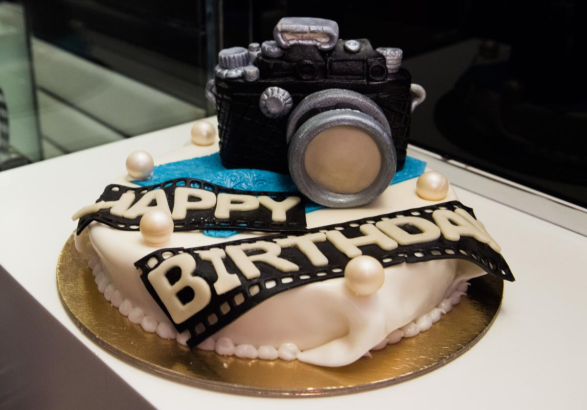 A birthday cake for photographer Rankin (not seen) during the Rankin Live x KaDeWe event at KaDeWe on April 30, 2016 in Berlin, Germany