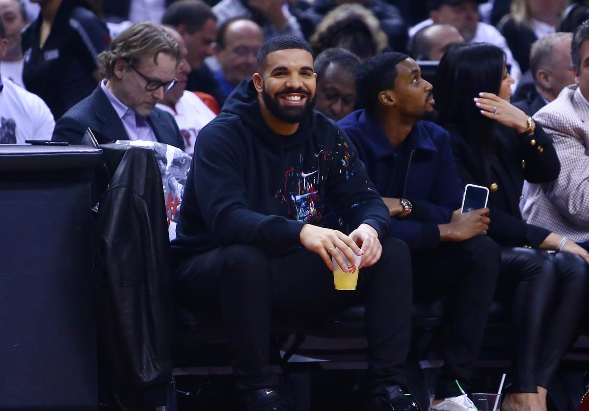 Drake looks on from their court side seat during Game Two of the second round of the 2019 NBA Playoffs between the Toronto Raptors and the Philadelphia 76ers at Scotiabank Arena on April 29, 2019 in Toronto, Canada