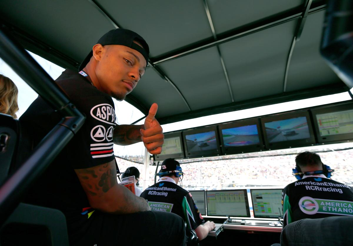 Bow Wow poses for a photo in the #3 American Ethanol Chevrolet driven by the Austin Dillon (not pictured) pit during the NASCAR Sprint Cup Series Auto Club 400 at Auto Club Speedway on March 20, 2016 in Fontana, California