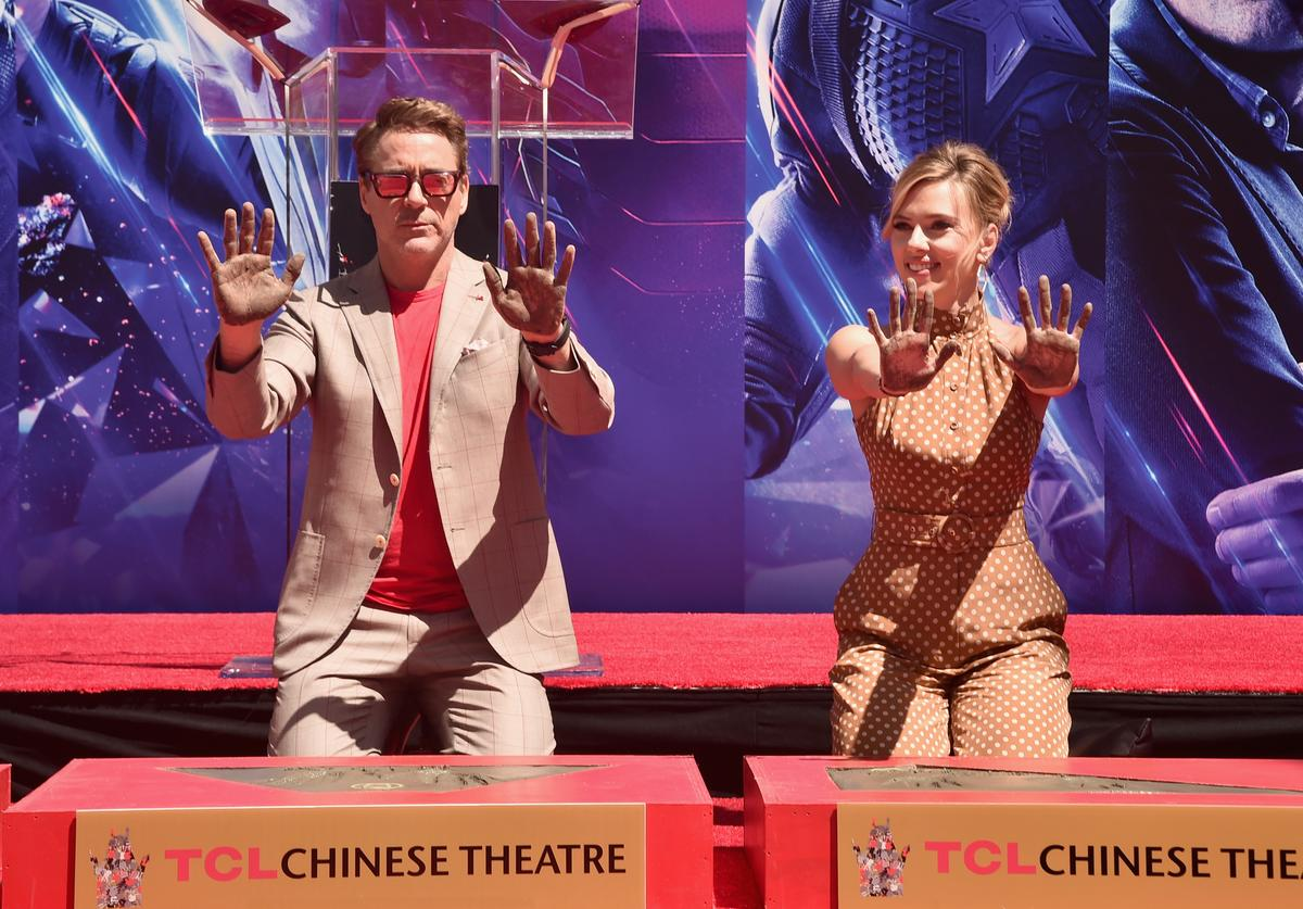 "Marvel Studios' ""Avengers: Endgame"" stars Robert Downey Jr. (L) and Scarlett Johansson at the Hand And Footprint Ceremony at the TCL Chinese Theatre on April 23, 2019 in Hollywood, California."