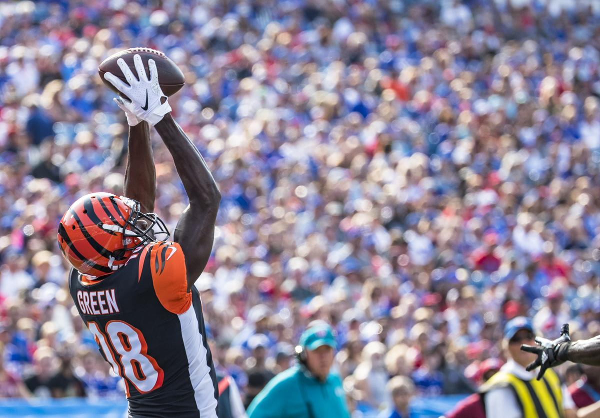 A.J. Green #18 of the Cincinnati Bengals makes a leaping touchdown reception during the first quarter of a preseason game against the Buffalo Bills at New Era Field on August 26, 2018 in Orchard Park, New York.