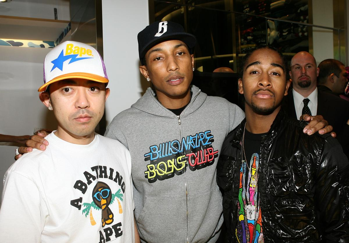 Designer Nigo, producer/rapper Pharrell Williams and singer Omarion during the BAPESTORE opening at Bape on April 23, 2008 in West Hollywood, California.