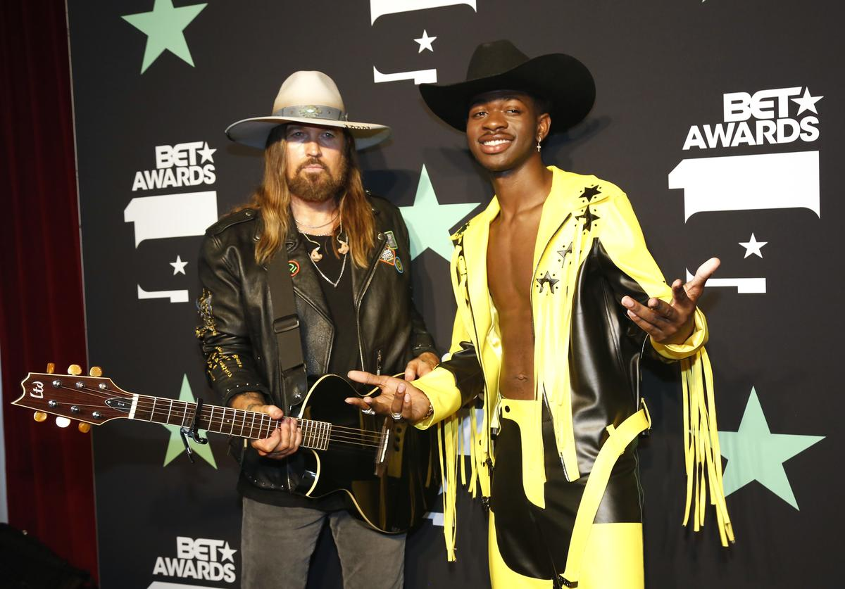 Billy Ray Cyrus (L) and Lil Nas X pose in the press room at the 2019 BET Awards at Microsoft Theater on June 23, 2019 in Los Angeles, California
