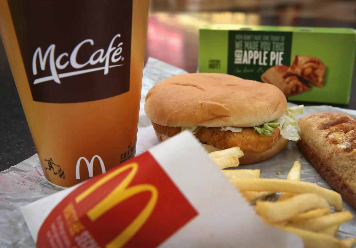 In this photo illustration, a McChicken sandwich sits with typical Dollar Menu items sold at a McDonald's restaurant on October 24, 2013 in Des Plaines, Illinois. McDonald's has announced it will make changes to its low-priced Dollar Menu, which includes items like coffee, small fries, hamburgers and apple pies. The new menu, dubbed the Dollar Menu and More, will offer some higher priced options such as the grilled Onion Cheddar Burger and a McChicken sandwich.