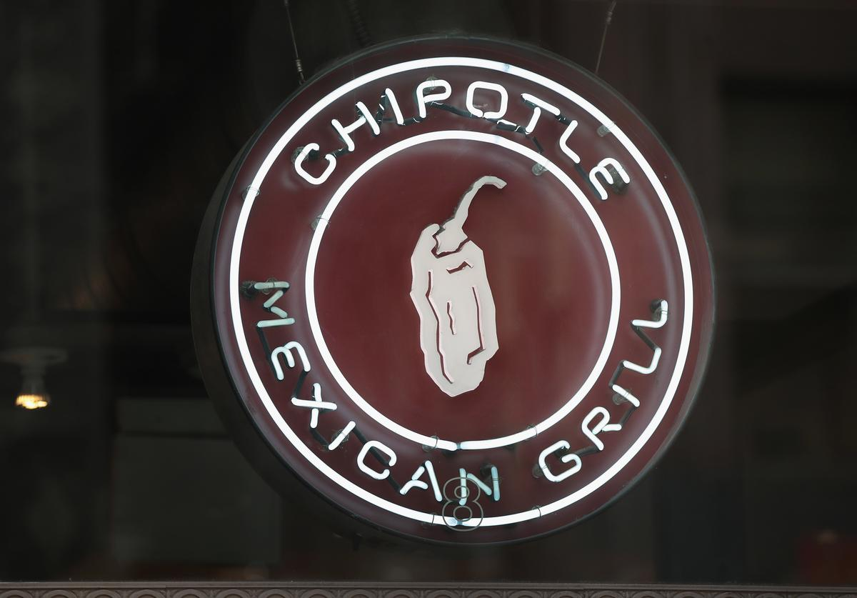 A sign marks the location of a Chipotle restaurant on October 25, 2017 in Chicago, Illinois. Chipotle stock fell more than 14 percent today after a weak 3Q earnings .