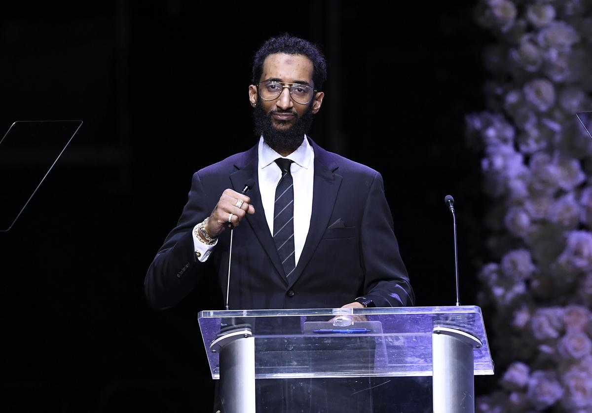 Samuel Asghedom speaks onstage during Nipsey Hussle's Celebration of Life at STAPLES Center on April 11, 2019 in Los Angeles, California
