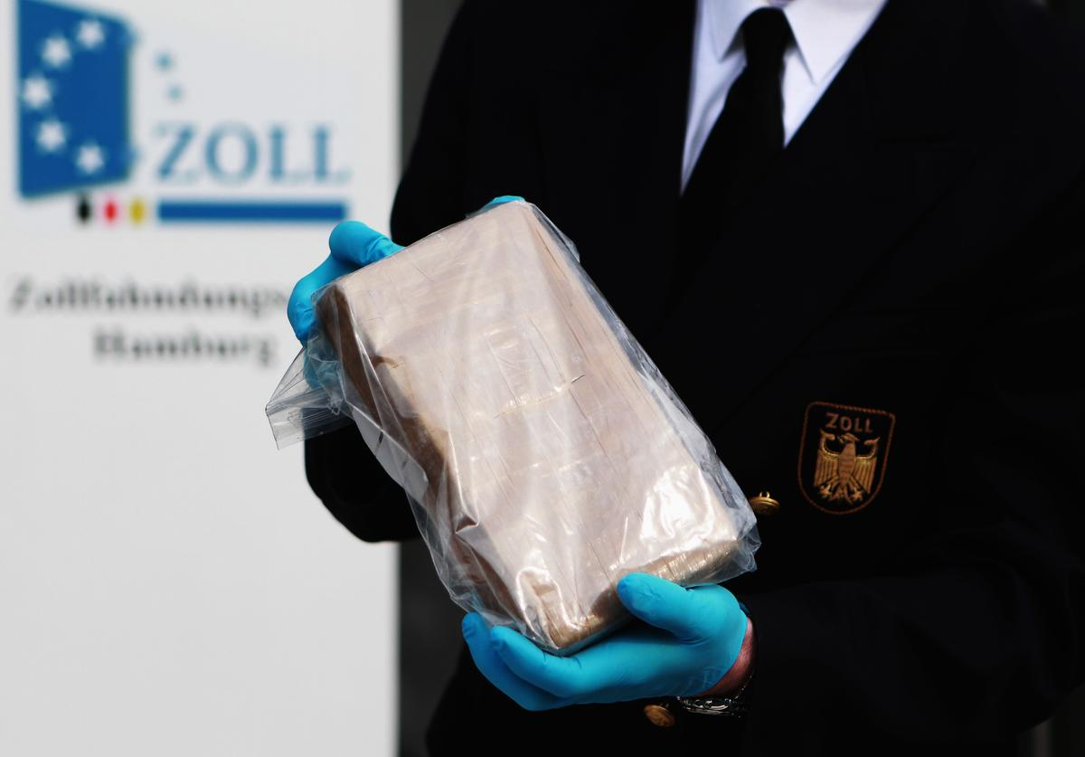 German customs agents shows a package containing confiscated cocaine at a press conference on March 4, 2012 in Hamburg, Germany.