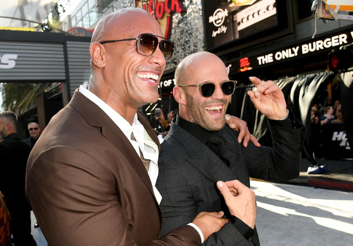 """Dwayne Johnson (L) and Jason Statham arrive at the premiere of Universal Pictures' """"Fast & Furious Presents: Hobbs & Shaw"""""""