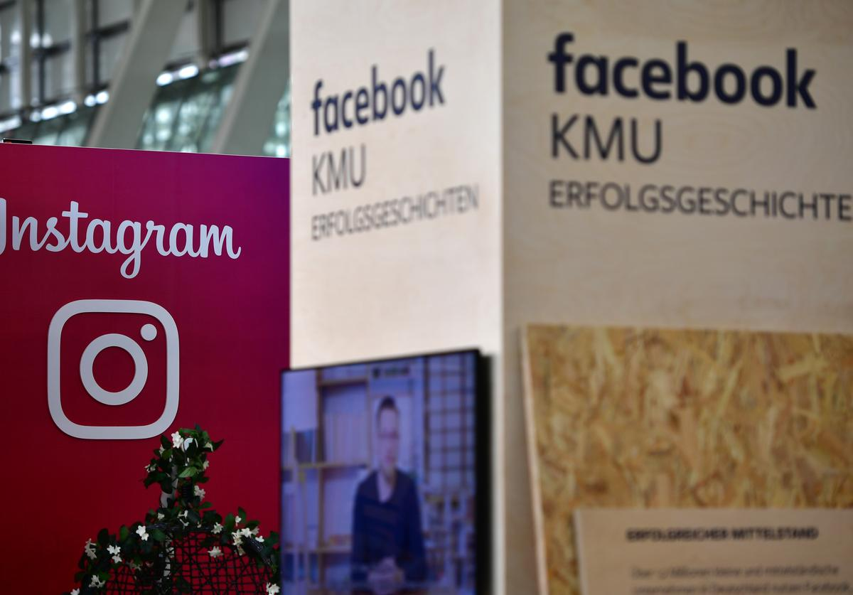 The Instagram and Facebook logos are displayed at the 2018 CeBIT technology trade fair on June 12, 2018 in Hanover, Germany