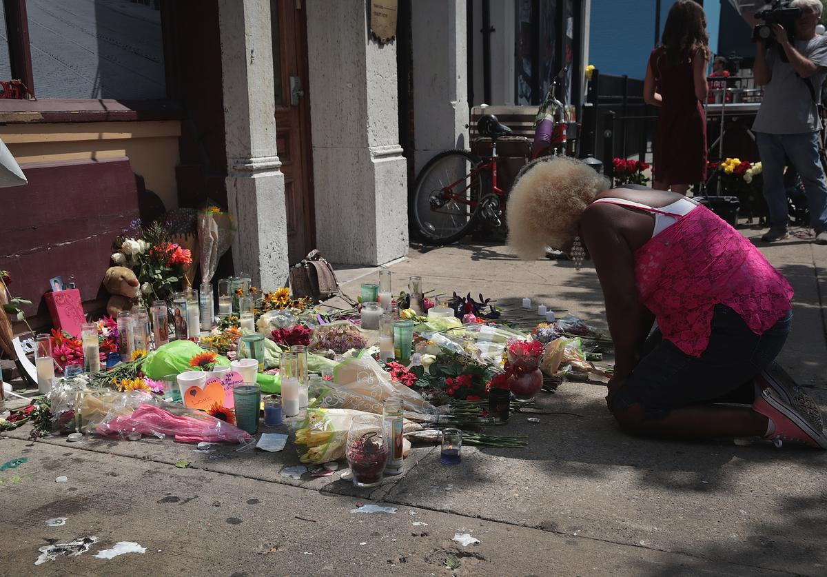 Annette Gibson-Strong visits a memorial to those killed in yesterday's mass shooting in the Oregon District on August 05, 2019 in Dayton, Ohio. Nine people were killed and another 27 injured when a gunman identified as 24-year-old Connor Betts opened fire with a AR-15 style rifle in the popular entertainment district. Betts was subsequently shot and killed by police. The shooting happened less than 24 hours after a gunman in El Paso, Texas opened fire at a shopping mall killing 22 people.