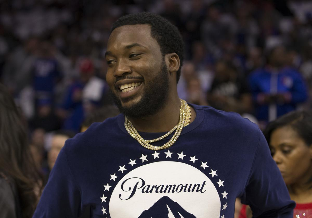 Meek Mill looks on prior to the game between the Chicago Bulls and Philadelphia 76ers at the Wells Fargo Center on October 18, 2018 in Philadelphia, Pennsylvania