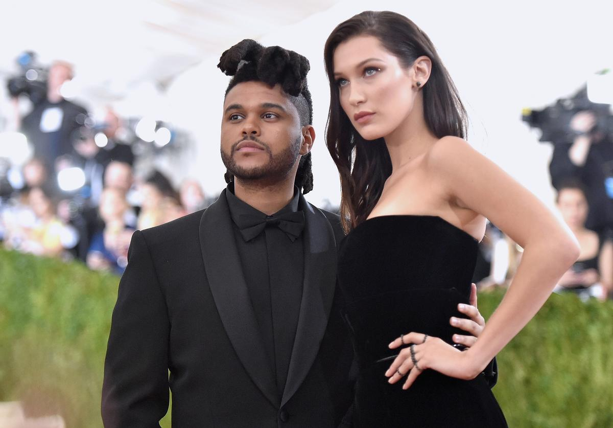 "The Weeknd (L) and Bella Hadid attend the ""Manus x Machina: Fashion In An Age Of Technology"" Costume Institute Gala at Metropolitan Museum of Art on May 2, 2016 in New York City"