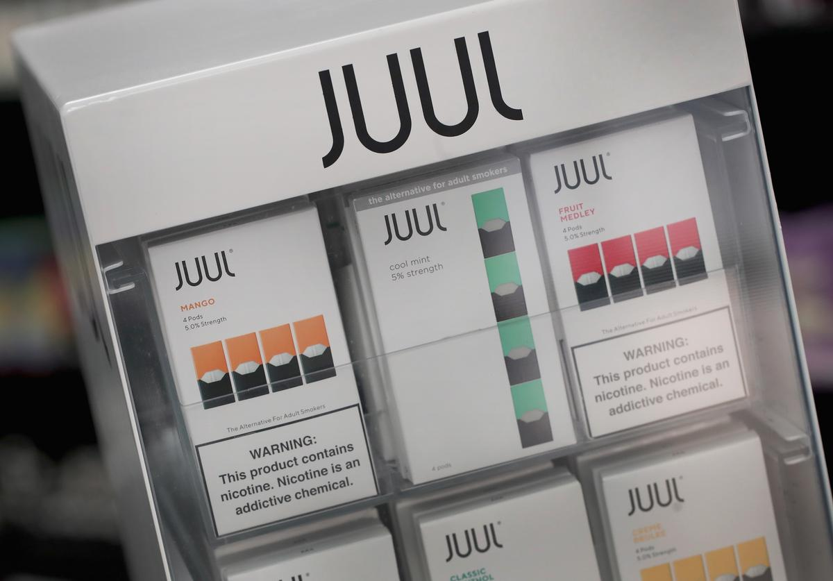 Electronic cigarettes and pods by Juul, the nation's largest maker of vaping products, are offered for sale at the Smoke Depot on September 13, 2018 in Chicago, Illinois