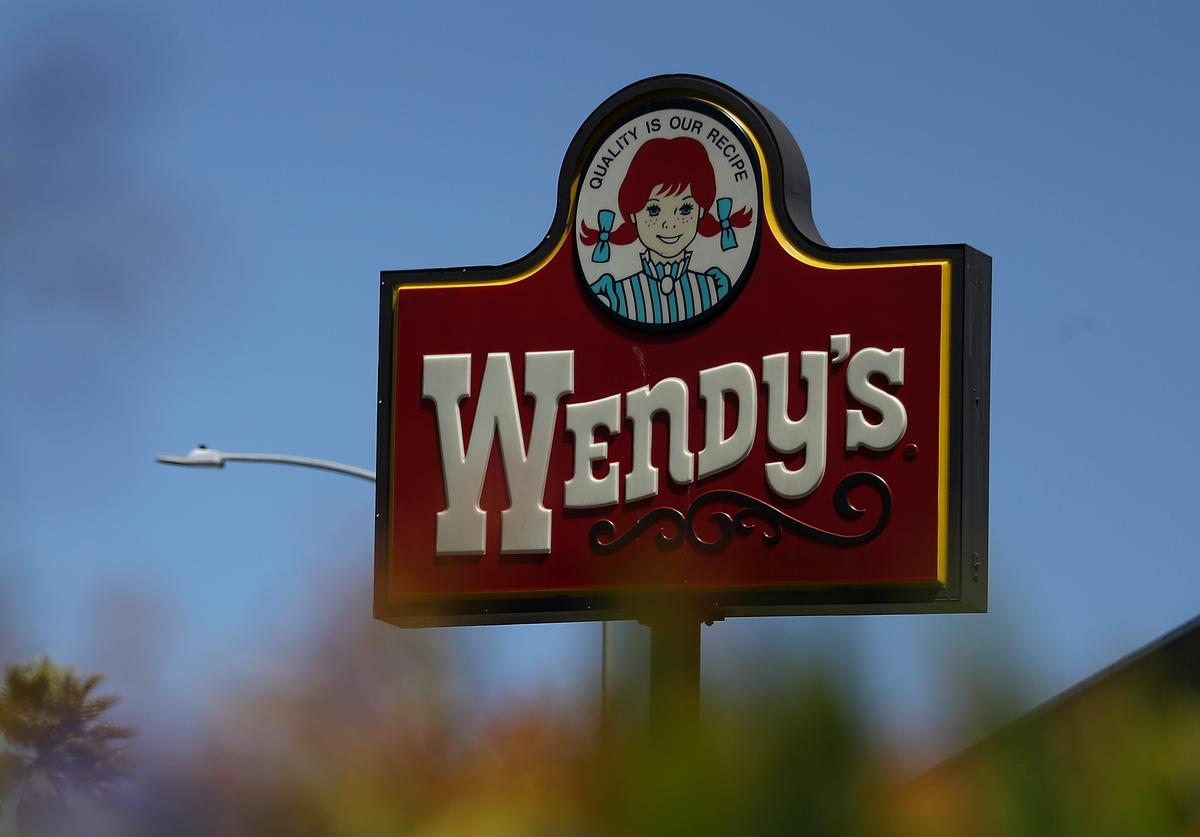 A sign is posted in front of a Wendy's restaurant on August 10, 2016 in Daly City, California. Wendy's reported a 22% decline in second quarter earnings with revenue of $382.7 million compared to $489.5 million one year ago.