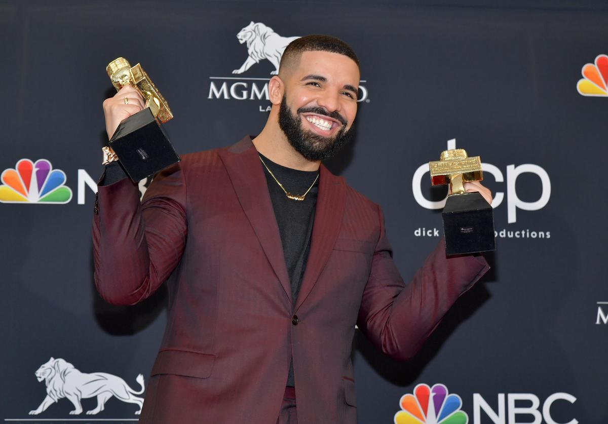"Drake poses with the awards for Top Artist, Top Male Artist, Top Billboard 200 Album for ""Scorpion"", in the press room during the 2019 Billboard Music Awards at MGM Grand Garden Arena on May 01, 2019 in Las Vegas, Nevada."