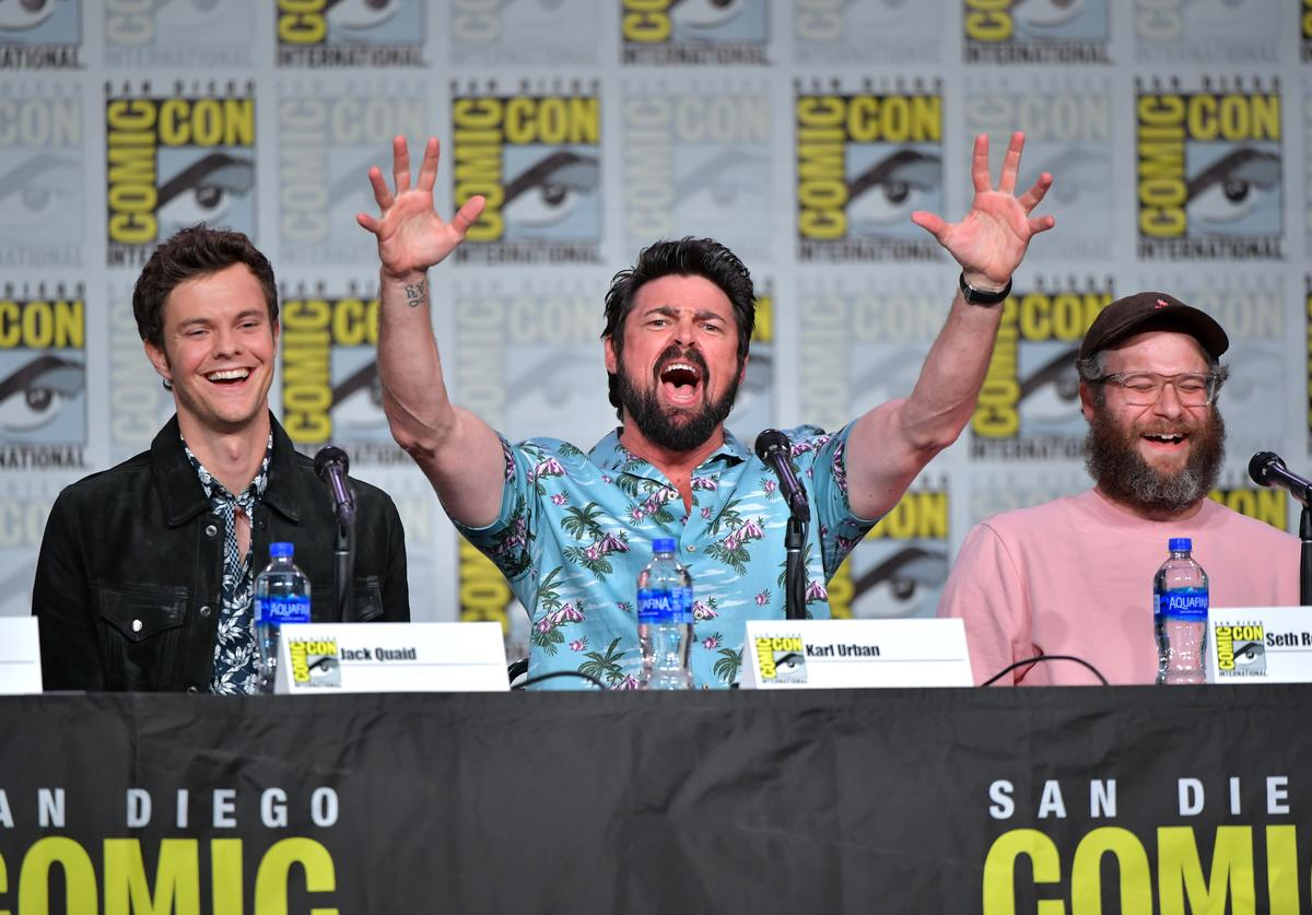 "Jack Quaid, Karl Urban, and Seth Rogen speak at ""The Boys"" Panel during 2019 Comic-Con International at San Diego Convention Center on July 19, 2019 in San Diego, California."