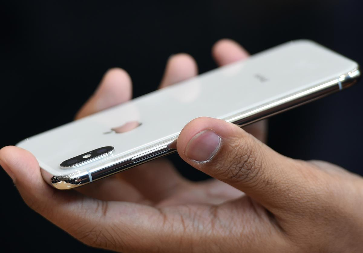 People try out the new iPhone X during a media event at Apple's new headquarters in Cupertino, California on September 12, 2017.
