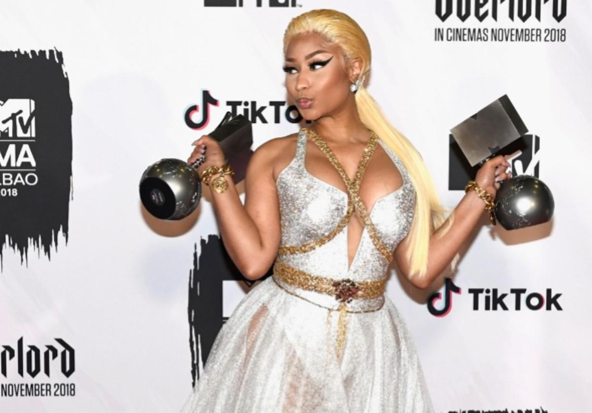 Nicki Minaj poses with Best Hip Hop and Best Look awards in the Winners room during the MTV EMAs 2018 at Bilbao Exhibition Centre on November 4, 2018 in Bilbao, Spain.