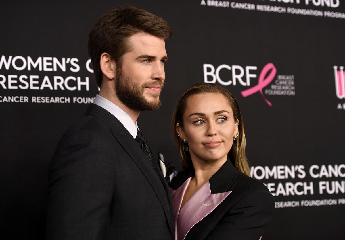 Liam Hemsworth and Miley Cyrus attends The Women's Cancer Research Fund's An Unforgettable Evening Benefit Gala