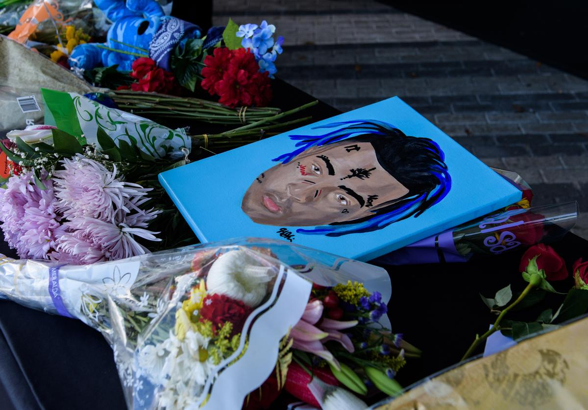 Fans leave items at a makeshift memorial outside the XXXTentacion Funeral & Fan Memorial at BB&T Center on June 27, 2018 in Sunrise, Florid