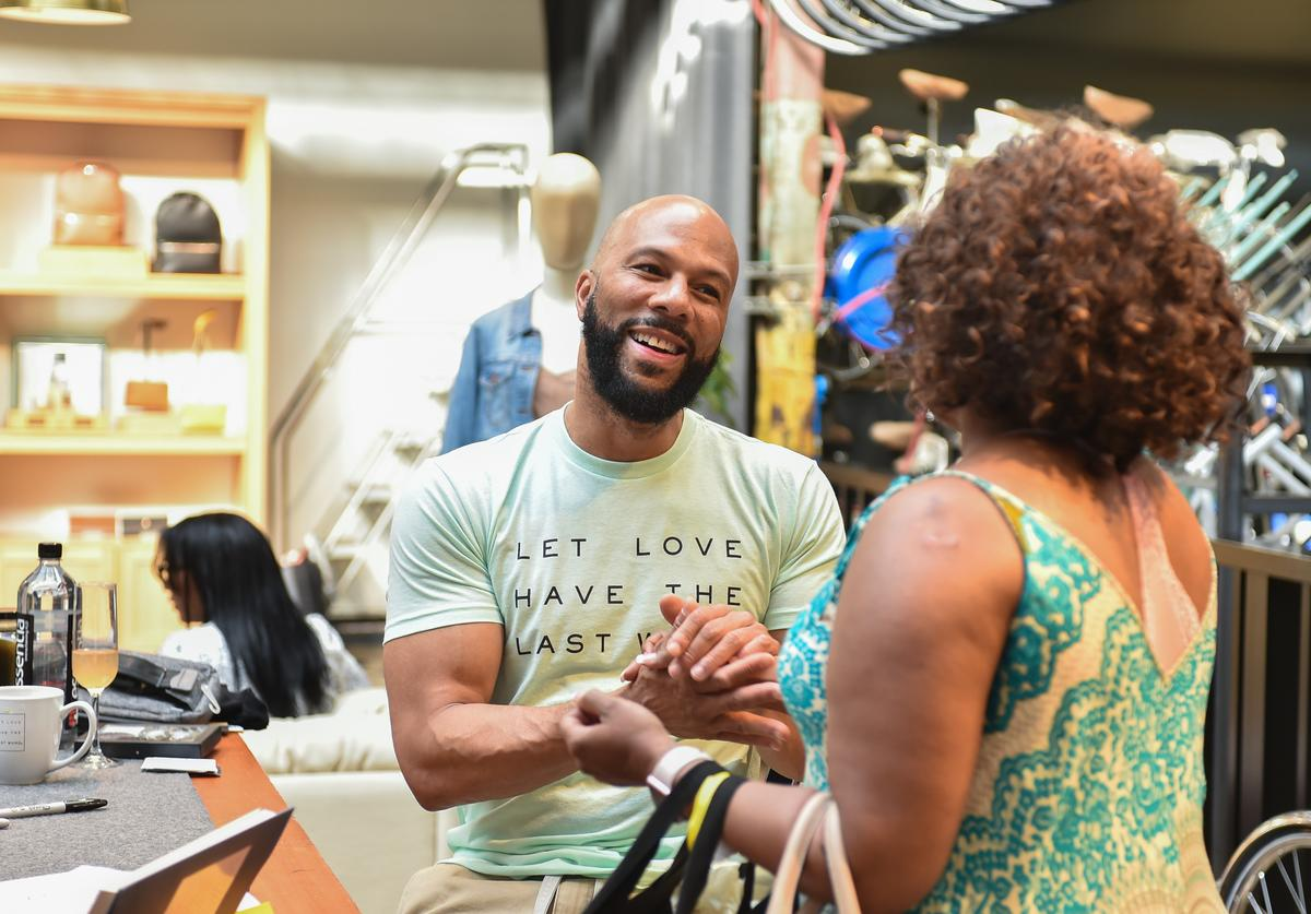 "Common greets fans at a signing event for his new book ""Let Love Have The Last Word"""
