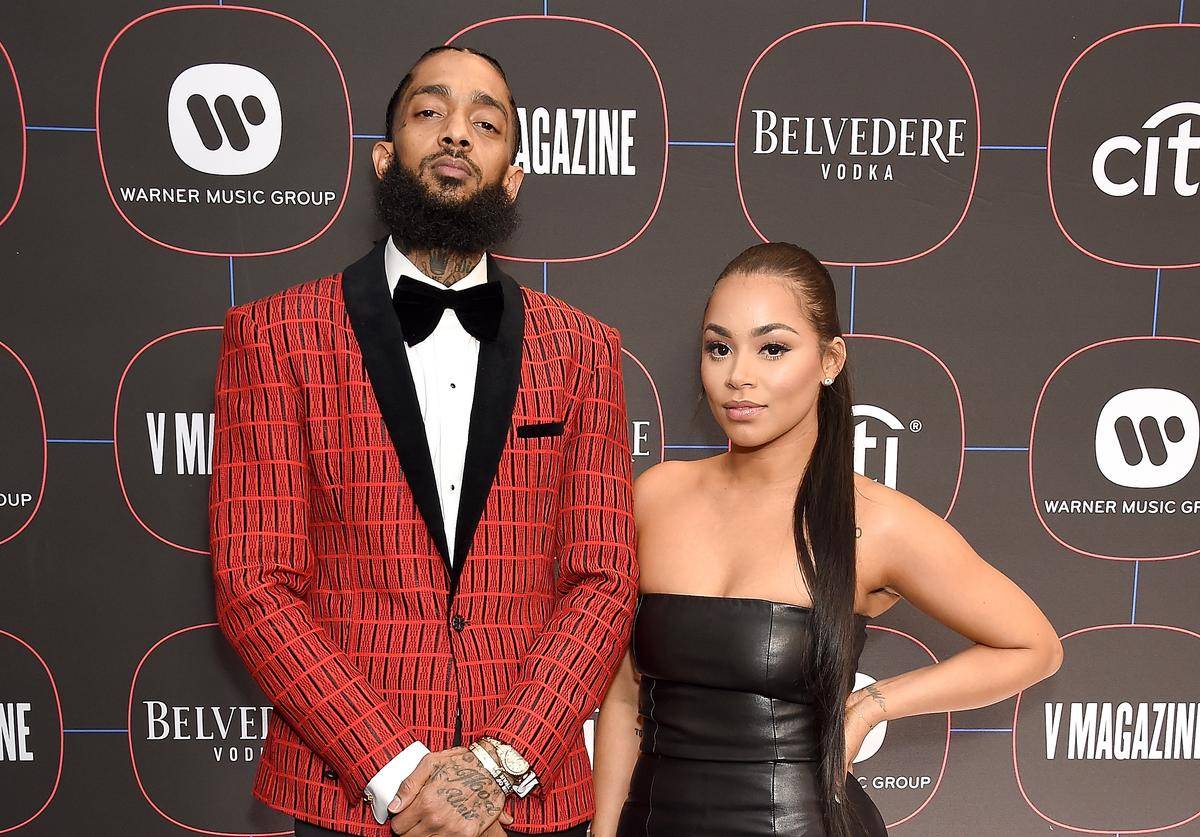 Nipsey Hussle and Lauren London arrive at the Warner Music Group Pre-Grammy Celebration at Nomad Hotel Los Angeles on February 7, 2019 in Los Angeles, California