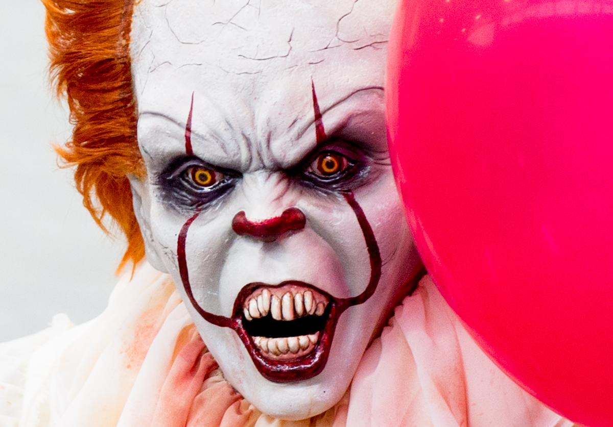 A cosplayer in character as Pennywise from IT seen during London Film and Comic Con 2019