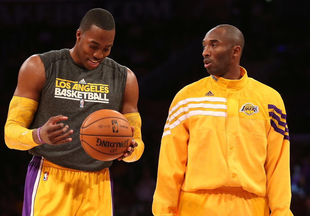 Dwight Howard #12 (L) and Kobe Bryant #24 of the Los Angeles Lakers talks as they warm up to play the Sacramento Kings at Staples Center on October 21, 2012 in Los Angeles, California.